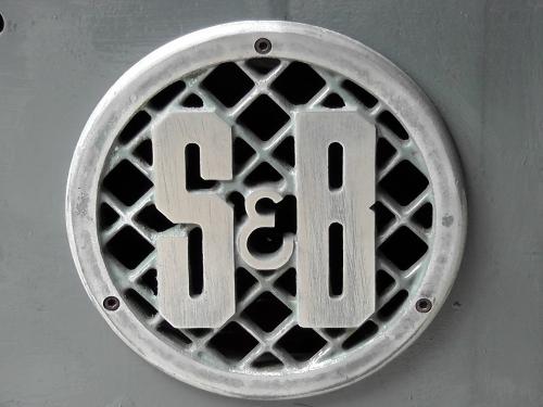 Cast aluminium brand plate.
