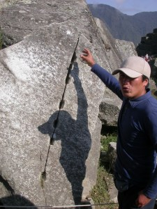 Our guide at the MachuPicchu quarry explains how the Inca stonemasons chipped rectangular slots then hammered in wedges, or allowed water to freeze and expand, to split the stone.