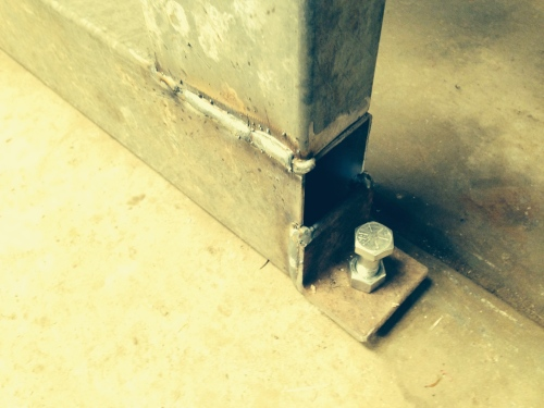 Levelling bolts at each corner