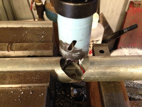 Using the bometal hole cutter in the drill press.  A staged photo, but it does show how it happened.