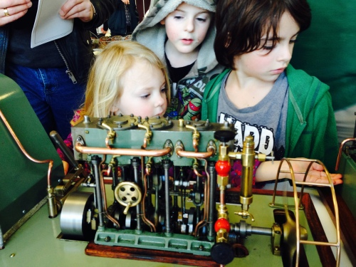 Some future model engineers, viewing a very nice, running, triple expansion steam engine.