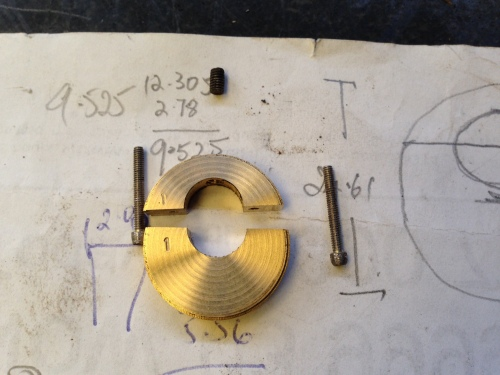 """The components of each eccentric.  The brass """"halves"""", the bolts and the grub screw."""