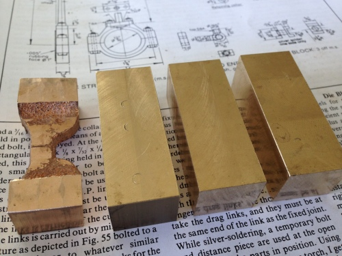 """Six valve rod """"yokes"""" need to be made, but there was only one casting, so I have decided to make them all from bar stock.  The dimensioned bar stock (10x16x55mm) is seen here, with the """"Model Engineer"""" article on the subject underneath."""