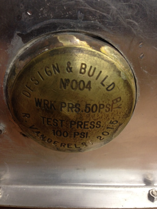 Rudy made the nameplate on an engraving machine, then formed the domed shape.